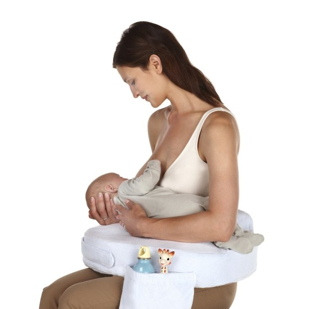 The no.1 Breastfeeding Support Pillow with Lactation Consultants. My Brest Friend is the only pillow that stays securely in place and does not shift or slide like other crescent shaped pillows. It provides support, comfort and security to both mom and baby, making breastfeeding more enjoyable and successful. Features: Deluxe Fabric Extra soft plush material Back Rest Helps you maintain good posture during feeding, preventing sore backs and necks Wrap Around Design Secures to the body, helping mom and baby maintain ideal positioning and latch on Arm and Elbow Rests Eliminate shoulder stress Convenient Pocket For nursing and other accessories Firm, Flat Front Cushion Eliminates gap between you and your baby, which keeps the baby from rolling in or away during breastfeeding Breastfeeding Ease Flat top firmness ideal for positioning baby Adjustable, Silent Release Strap Deluxe strap has Velcro and silent release buckle for easy, one hand use Includes pillow insert and one slipcover. Additional slipcovers sold separately. 19 kids and counting my_brest_friend_nursing_pillow sew many ways kimi bay top must have items for baby essentials children nursery mom mother baby shower gift